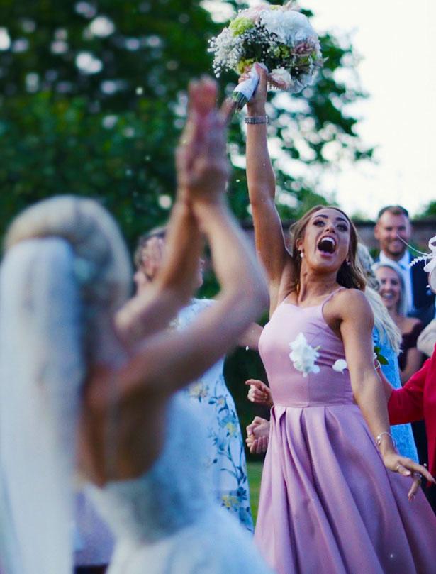 Wedding Videographer flower catch